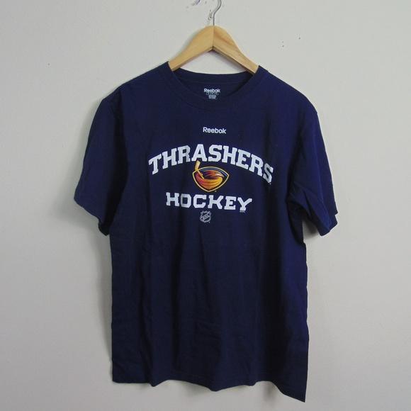 0e41a0ad8ce Thrashers Hockey Men L NHL T-Shirt Blue Reebok. M_5b99e509819e9030518637c1